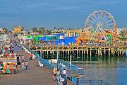 Pacific Park Pier Santa Monica CA pier near sunset,family amusement park large New Pacific Ferris wheel Roller Coaster moving over the ocean