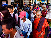 20 NOVEMBER 2017 - YANGON, MYANMAR: People getting off the Dala Ferry in Yangon leave the ferry terminal. Tens of thousands of commuters ride the ferry every day. It brings workers into Yangon from Dala, a working class community across the river from Yangon. A bridge is being built across the river, downstream from the ferry to make it easier for commuters to get into the city.     PHOTO BY JACK KURTZ