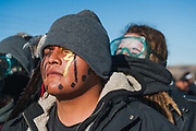 MANDAN, ND - Opponents of the Dakota Access Pipeline demonstrate against it after a convoy of protestors traveled from the Oceti Sakowin camp in Cannon Ball to an industrial site associated with the pipeline in Mandan, North Dakota, November 12, 2016.