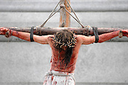 An outdoor performance of the Passion of Christ takes place in Trafalgar Square on 2nd April 2010. More than 100 actors from the Wintershall Estate near Bramley, Surrey, acted out Christ's trial and execution to mark Good Friday. © under license to London News Pictures.