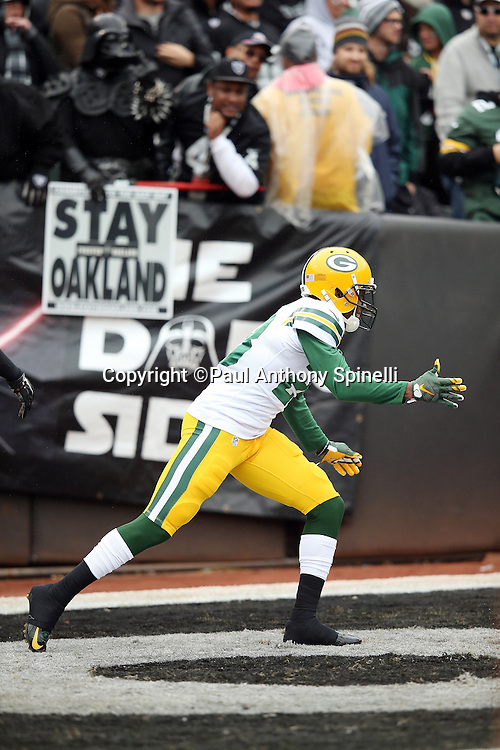 Green Bay Packers cornerback Damarious Randall (23) celebrates after intercepting a first quarter pass and running it back for a 43 yard touchdown and a 14-0 Packers lead during the 2015 week 15 regular season NFL football game against the Oakland Raiders on Sunday, Dec. 20, 2015 in Oakland, Calif. The Packers won the game 30-20. (©Paul Anthony Spinelli)