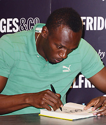 Usain Bolt book signing. <br /> Legendary Olympic athlete signs copies of his autobiography Faster than Lightning at Selfridges. Book was released September 12. Selfridges, 400 Oxford Street, United Kingdom. Thursday, 19th September 2013. Picture by Nils Jorgensen / i-Images