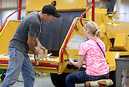 Two employees work on the back of a brush chipper on the assembly line in Plant 4 at Vermeer in Pella, Iowa on Thursday, July 28, 2011.