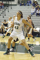 17 December 2011:  Annie Brown protects the lane and the baseline during an NCAA womens division 3 basketball game between the St. Francis Fighting Saints and the Illinois Wesleyan Titans in Shirk Center, Bloomington IL