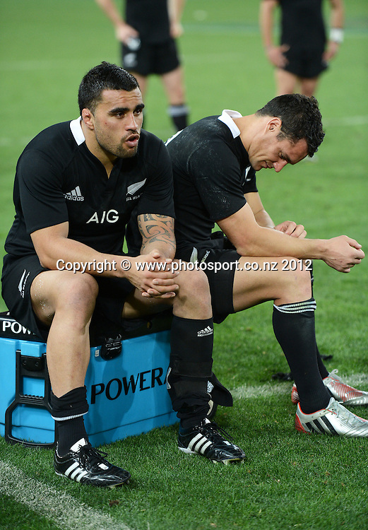 All Blacks players Liam Messam and Dan Carter at the end of the game. The Rugby Championship and Bledisloe Cup test match, Australain Wallabies v New Zealand All Blacks, Suncorp Stadium, Brisbane, Saturday 20 October 2012. Photo Credit: Andrew Cornaga/Photosport.co.nz