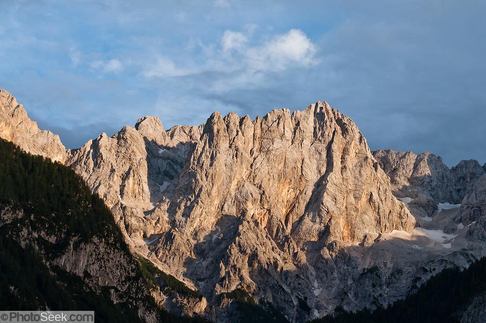 "The mountain of Siroka pec (2497 meters/8192 feet) rises high in the Martuljek mountain group in Triglav National Park (Triglavski narodni park, TNP) in the Julian Alps, above the town of Gozd Martuljek (""Martuljek Forest""), Slovenia, Europe. Latitude/Longitude: 46.45000°N / 13.85000°E."