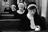 A group of nuns participate in morning prayer services at Sisters of Saint Basil The Great motherhouse Tuesday May 1, 1990 in Jenkintown, Pennsylvania. (Photo by William Thomas Cain/Cain Images)