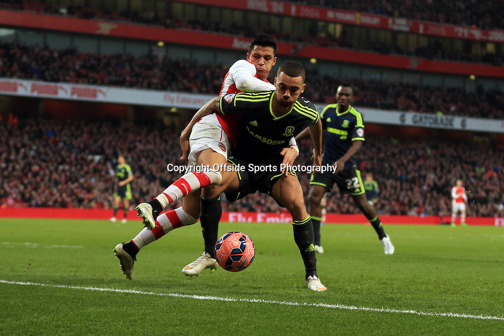 15 February 2015 - The FA Cup Fifth Round - Arsenal v Middlesbrough - Ryan Fredericks of Middlesbrough  tangles with Alexis Sanchez of Arsenal - Photo: Marc Atkins / Offside.