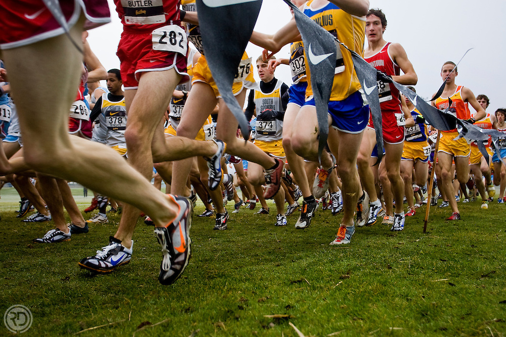Runners in the NXN 2009 Boy's Championship race make their way through the first turn on the course.<br /> <br /> Nike Cross Nationals (NXN)<br /> Boy's Championship Race<br /> Portland Meadows Race Track<br /> Portland, OR<br /> December 5, 2009