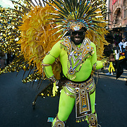A man shows of his yellow costume with a big smile outside the Hackney Empire Theater in East London, United Kingdom,Sept 11 2016. The annual Hackney Carnival took place on a hot summers day and the procession of dancers dressed in various outfits moved through the streets to much joy of the many bystanders.