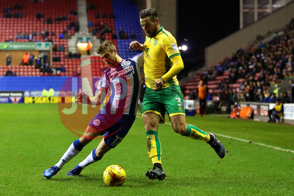 Michael Jacobs of Wigan Athletic tackles Mitchell Dijks of Norwich City - Mandatory by-line: Matt McNulty/JMP - 07/02/2017 - FOOTBALL - DW Stadium - Wigan, England - Wigan Athletic v Norwich City - Sky Bet Championship