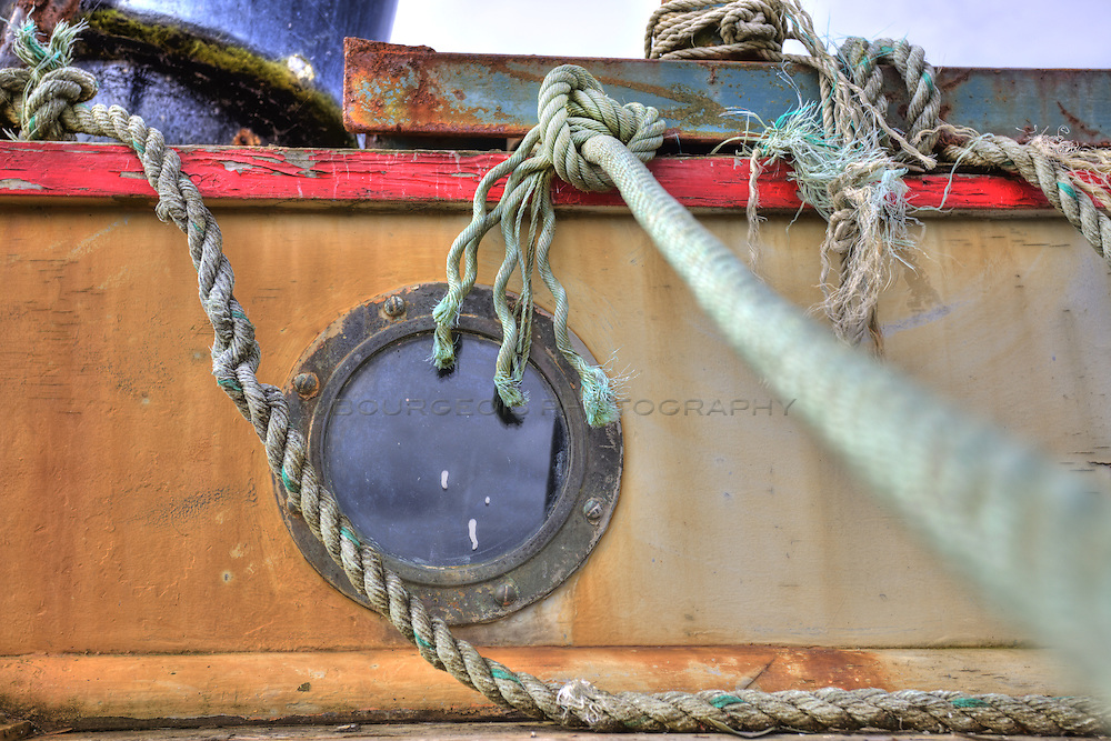 Photo of a boat with lines and a portal hole window