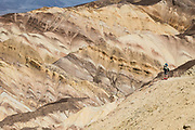 Hike Golden Canyon to see colorful geologic patterns in Death Valley National Park, California, USA.