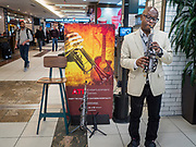 17 FEBRUARY 2020 - ATLANTA, GEORGIA:   Saxophonist Jason Bitten performing in Atlanta's Hartsfield–Jackson Atlanta International Airport, the world's busiest airport by passenger count. The airport plays musicians to perform in the airport's food courts.  PHOTO BY JACK KURTZ