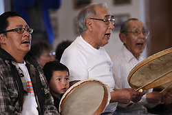 USA ALASKA POINT HOPE 22JUL12 - Elders sing and play their drums during a community meeting and dance at Point Hope, North Slope Borough, Alaska. ..The skins of the Inupiat drums are made of liver membrane from the bowhead whale. Music is important for the Inupiat people living in the Arctic: most families have their own songs and dances that have been handed down from their ancestors...Point Hope is one of the oldest continually occupied sites in North America.....Photo by Jiri Rezac / Greenpeace....© Jiri Rezac / Greenpeace