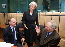 Christine Lagarde, France's finance minister, center, speaks with Wolfgang Schaeuble, Germany's finance minister, left, and Luc Frieden, Luxembourg's finance minister, during an emergency meeting of euro zone finance ministers in Brussels, on Sunday, May 2, 2010. Greece accepted an unprecedented bailout from the European Union and International Monetary Fund worth more than 110 billion euros ($146 billion). (Photo © Jock Fistick)