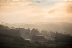 © Licensed to London News Pictures. 31/03/2016. Baildon UK. Picture shows fog hanging over the village of Baildon in this morning's sunrise in Yorkshire. Photo credit: Andrew McCaren/LNP