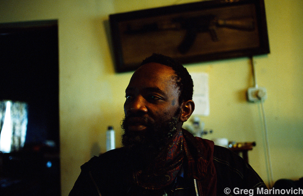 An IFP warlord, whose name escapes me completely,  in his office in northern KwaZulu Natal, South Africa, 1994.