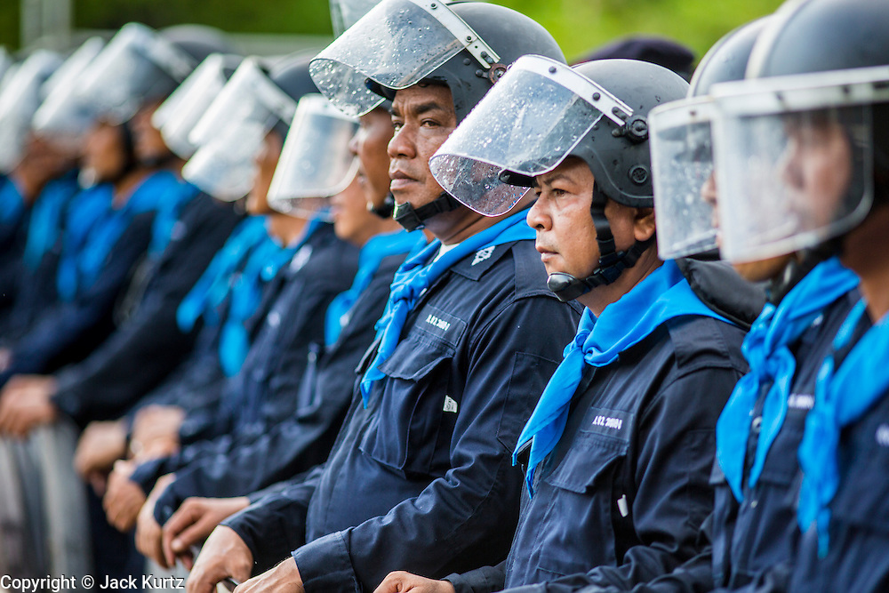 23 NOVEMBER 2012 - BANGKOK, THAILAND:  Thai riot police in formation near Government House in Bangkok Friday. Thai authorities have imposed the Internal Security Act (ISA), that enables police to call on the army if needed to keep order, and placed thousands of riot police in the streets around Government House in anticipation of a large anti-government protest Saturday. The group sponsoring the protest, Pitak Siam, said up to 500,000 people could turn out to protest against the government. They are protesting against corruption in the current government and the government's unwillingness to arrest or pursue fugitive former Prime Minister Thaksin Shinawatra, deposed in 2006 coup and later convicted on corruption charges. The current Thai Prime Minister is Yingluck Shinawatra, Thaksin's sister.      PHOTO BY JACK KURTZ