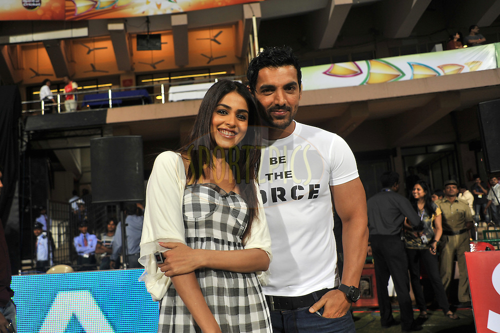 Bollywood Actor John Abrahim and Jenilia D'souza during match 1 of the NOKIA Champions League T20 ( CLT20 )between the Royal Challengers Bangalore and the Warriors held at the  M.Chinnaswamy Stadium in Bangalore , Karnataka, India on the 23rd September 2011..Photo by Pal Pillai/BCCI/SPORTZPICS