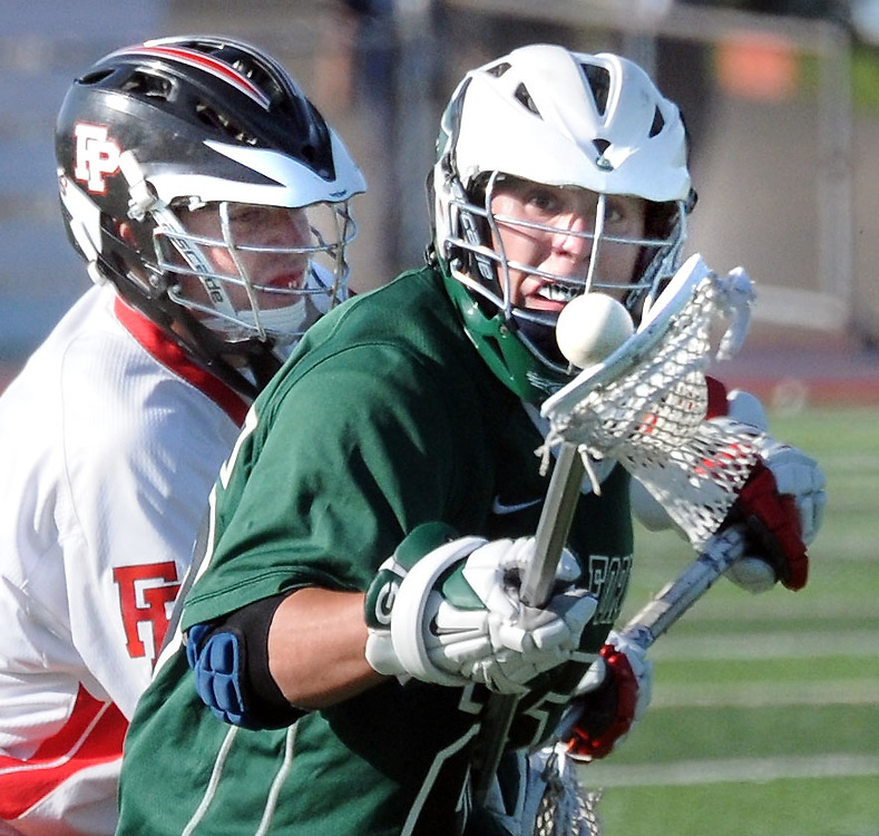 (Mara Lavitt &mdash; New Haven Register) <br /> May 29, 2014 West Haven<br /> SCC 2014 boys lacrosse championship at Ken Strong Stadium, West haven High School. Fairfield Prep 8, Guilford 5. FP's Burke Smith and Guilford's Nate Tepley.<br /> mlavitt@newhavenregister.com