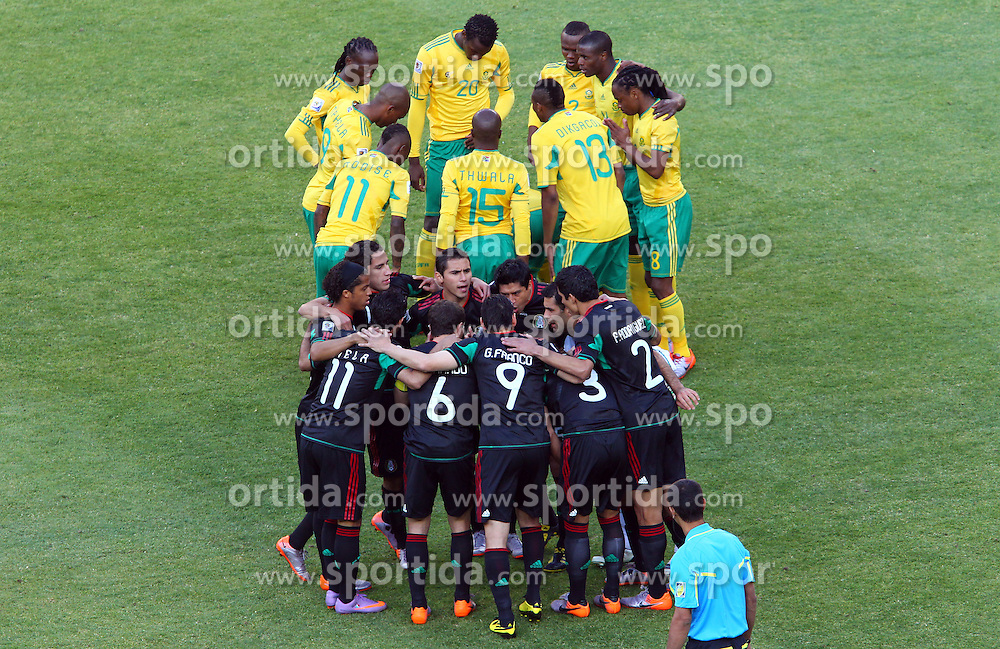 Players of South Africa (yellow) and Mexico during the Group A first round 2010 FIFA World Cup South Africa match between South Africa and Mexico at Soccer City Stadium on June 11, 2010 in Johannesburg, South Africa.  (Photo by Vid Ponikvar / Sportida)