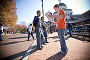 Mason King, a junior enviromental biology major, helps inform Amber Rose Cavender, a sophomore anthropology major and Matthew Urminski, a senior specialized studies major outside Baker Center on Tuesday afternoon. King was volunteering for the Student Sierra Coalition, helping to encourage voting.