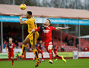 Leon Legge of Cambridge United and Matt Harrold of Crawley Town  battle for a ball over the top during the Sky Bet League 2 match between Crawley Town and Cambridge United at the Checkatrade.com Stadium, Crawley, England on 9 January 2016. Photo by Andy Walter.