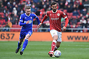 Bristol City midfielder Marlon Pack (21) plays the ball away from Ipswich Town striker Freddie Sears (20) 0-0 during the EFL Sky Bet Championship match between Bristol City and Ipswich Town at Ashton Gate, Bristol, England on 17 March 2018. Picture by Alan Franklin.