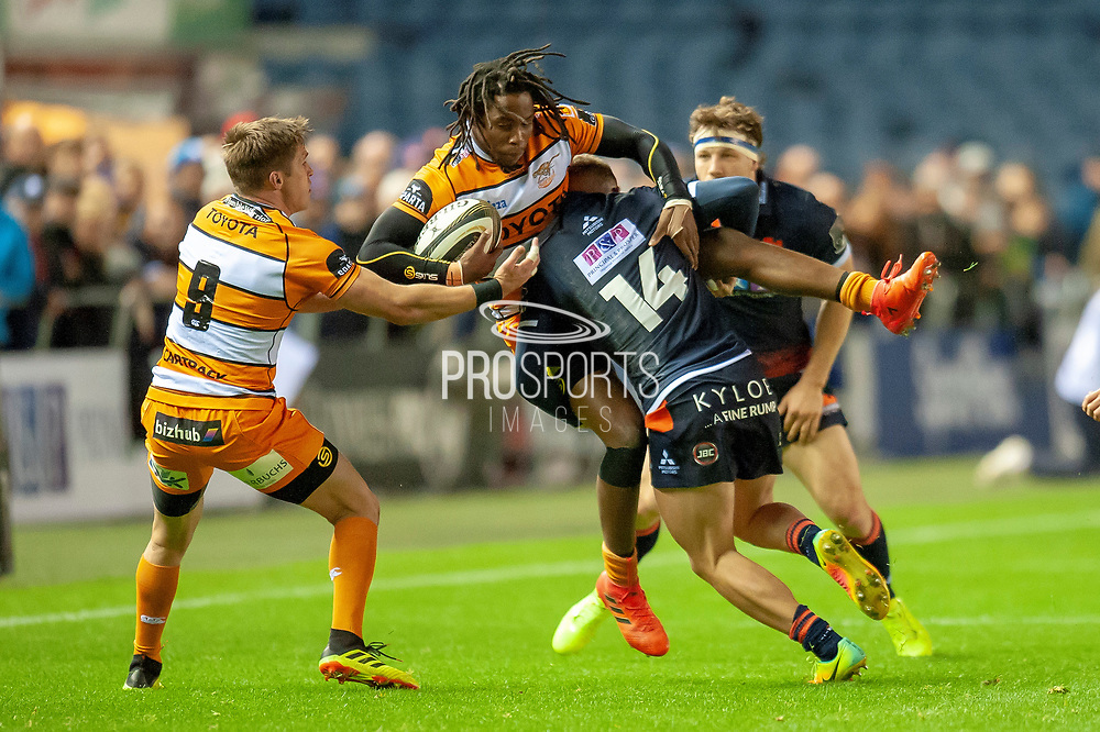 Darcy Graham (#14) of Edinburgh Rugby tackles Rabz Mazwane (#11) during the Guinness Pro 14 2018_19 match between Edinburgh Rugby and Toyota Cheetahs at BT Murrayfield Stadium, Edinburgh, Scotland on 5 October 2018.