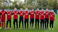 NEWPORT, WALES - Thursday, September 25, 2014: Wales' substitutes sing the national anthem before the Under-16's International Friendly match against France at Dragon Park. L-R: Dylan Levitt, goalkeeper George Ratcliffe, Rhys Norrington-Davies, Ryan Stirk, Mitchell Clark, Max Smallcombe, Brandon Burrows, Liam Cullen, Kieran Evans. (Pic by David Rawcliffe/Propaganda)