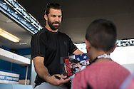 HOUSTON, TX - OCTOBER 3:  Luke Rockhold signs an autograph for a fan during the UFC 192 fan village at the Toyota Center on October 3, 2015 in Houston, Texas. (Photo by Cooper Neill/Zuffa LLC/Zuffa LLC via Getty Images) *** Local Caption *** Luke Rockhold