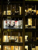 Group of business people having office party view from building exterior