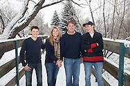 It was -10 degrees when we took this picture.   With all the family in town for a very brief time over christmas, it was the only time that pictures could be taken.  Braving the freezing temperatures we headed out for what turned out to be a surprisingly fun (and super speedy) photo-shoot.  Being an ice skating fans the family were used to the cold.  Bravely shedding their coats we found a cute location at this Niwot bridge and took this shot.   I love the way the family is interacting, laughing and having fun.   I believe that when you look at a family portrait it should remind you of good times.