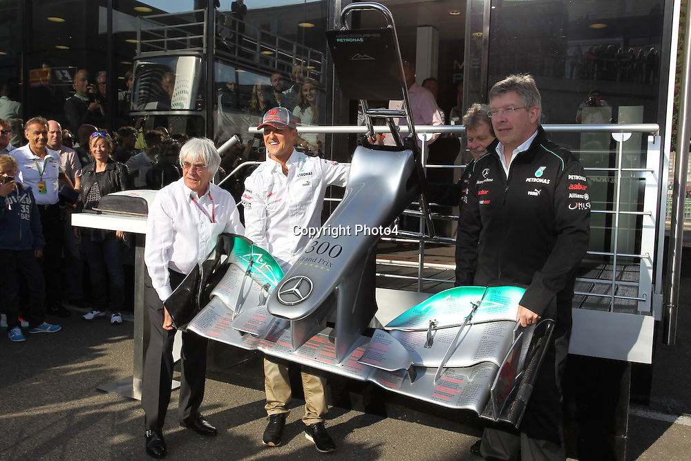 &copy; Photo4 / LaPresse<br /> 01/9/2012 Spa-Francorchamps, Belgium<br /> Belgian Grand Prix, Spa-Francorchamps 30 August - 02 September 2012<br /> In the pic: Michael Schumacher (GER), Mercedes AMG Petronas F1 Team celebrate his 300 Gp, in the pictures with Bernie Ecclestone (GBR) and Ross Brawn (GBR), Team Principal, Mercedes GP