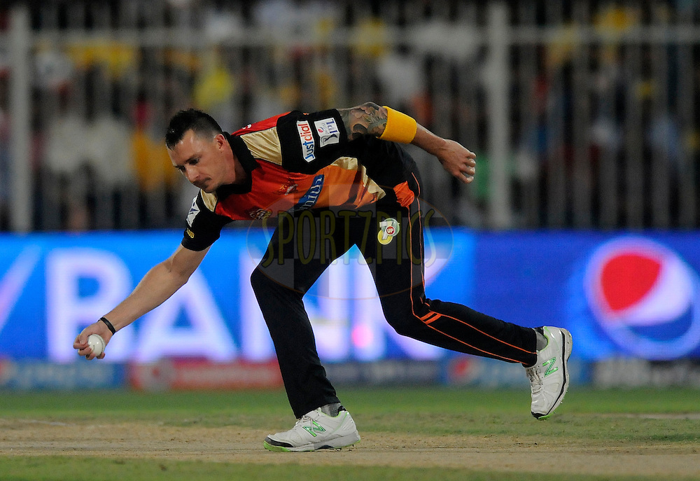Dale Steyn of the Sunrisers Hyderabad stops a ball of his own bowling during match 16 of the Pepsi Indian Premier League 2014 between the Delhi Daredevils and the Mumbai Indians held at the Sharjah Cricket Stadium, Sharjah, United Arab Emirates on the 27th April 2014<br /> <br /> Photo by Pal Pillai / IPL / SPORTZPICS