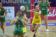 Australian goal defence Jo Weston passes the ball off in the third quarter during the 2019 Netball World Cup match between Australia and Northern Ireland at M & S Bank Arena, Liverpool, United Kingdom on 12 July 2019.