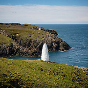 At the harbour mouth to  the old quarry site of Porthgain a couple of white channel markers