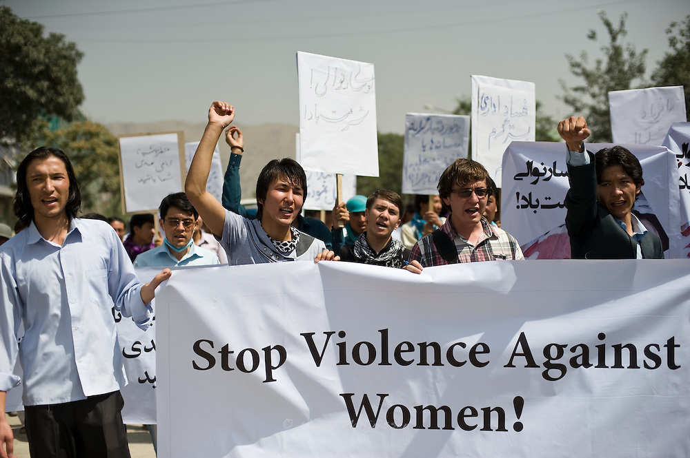 Young men that support the organization Young Women for Change, protest against violence against women in Afghanistan.