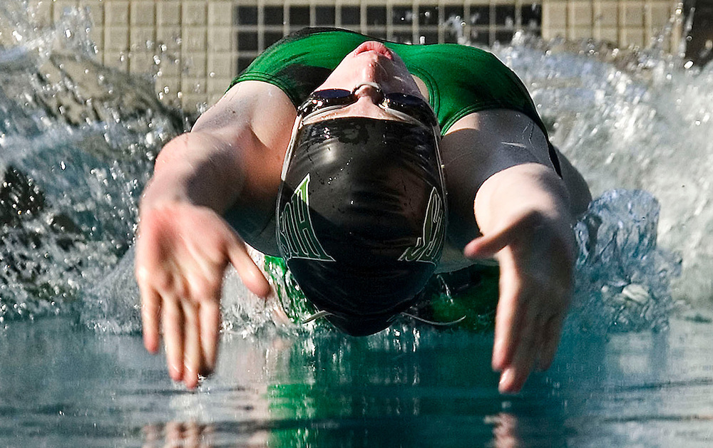 THIS IS FOR ZONES----Kristi Edwards of Hillcrest competes in the 100 yard Backstroke race at the Region 2 swim championships with Alta, Brighton, Hillcrest, Jordan, Skyline, and Taylorsville held at the Fairmont Aquatic Center Saturday January 27, 2006 in Salt Lake City, Utah. August Miller/Deseret Morning News