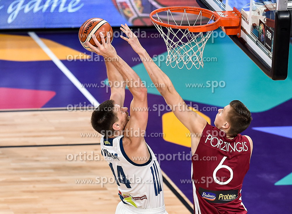 Gasper Vidmar of Slovenia vs Kristaps Porzingis of Latvia during basketball match between National Teams of Slovenia and Latvia at Day 13 in Round of 16 of the FIBA EuroBasket 2017 at Sinan Erdem Dome in Istanbul, Turkey on September 12, 2017. Photo by Vid Ponikvar / Sportida