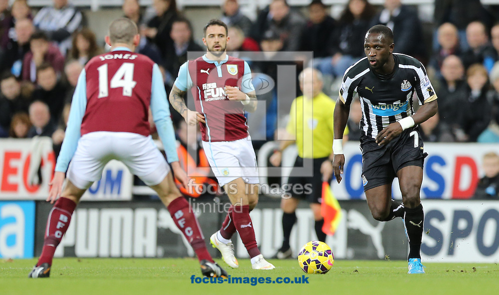 Moussa Sissoko (r) of Newcastle United takes on David Jones of Burnley during the Barclays Premier League match at St. James's Park, Newcastle<br /> Picture by Simon Moore/Focus Images Ltd 07807 671782<br /> 01/01/2015