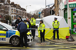A cordon is in place as a tent covers the spot where a man in his 30s was stabbed outside an off licence in the early hours of Sunday February 10th on Lordship Lane, East Dulwich in London. London, February 10 2019.