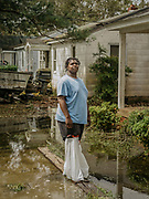 "Anthony Tyrie, 22, fled with his mother before the storm, but came back to a home that had flooded in some places three feet with storm surge. ""I've never been without a house,"" Tyrie said. ""I didn't even know what FEMA was, I never had a reason to call until now."""