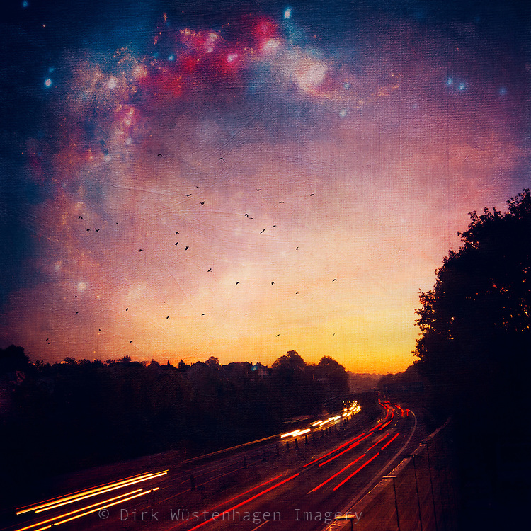 Long exposure of a highway at sunrise with a dreamy colourful starry sky