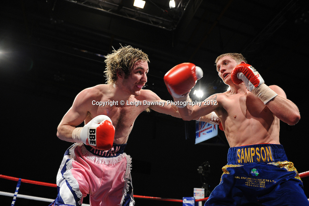 Jamie Sampson (blue shorts) defeats Arran McKelvie in a Lightweight contest on 3rd March 2012 at the Hillsborough Leisure Centre. Frank Maloney & Dennis Hobson Promotions © Leigh Dawney Photography 2012.