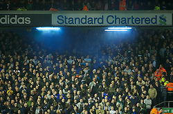 LIVERPOOL, ENGLAND - Tuesday, March 13, 2012: Despite being two goals down Everton supporters set-off a blue flare during the Premiership match against Liverpool at Anfield. (Pic by David Rawcliffe/Propaganda)