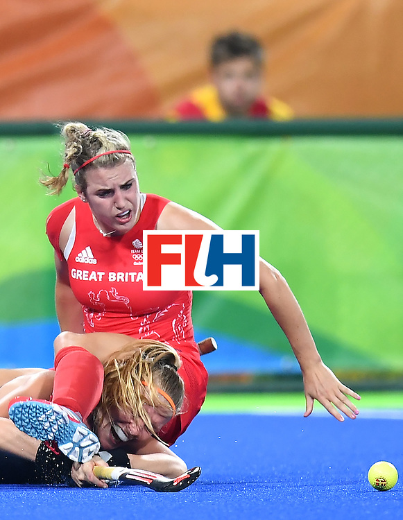 Britain's Lily Owsley (R) falls over Netherlands' Caia van Maasakker during the women's Gold medal hockey Netherlands vs Britain match of the Rio 2016 Olympics Games at the Olympic Hockey Centre in Rio de Janeiro on August 19, 2016. / AFP / MANAN VATSYAYANA        (Photo credit should read MANAN VATSYAYANA/AFP/Getty Images)