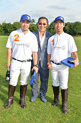 Left to right, TOP SRIVADDHANAPRABHA , VICHAI SRIVADDHANAPRABHA and TAL SRIVADDHANAPRABHA at the Laureus Polo held at Ham Polo Club, Ham, Richmond, Surrey on 18th June 2015.