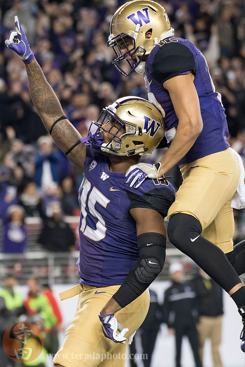 December 2, 2016; Santa Clara, CA, USA; Washington Huskies tight end Darrell Daniels (15) is congratulated by wide receiver Aaron Fuller (12) for scoring a touchdown against the Colorado Buffaloes during the second quarter in the Pac-12 championship at Levi's Stadium.